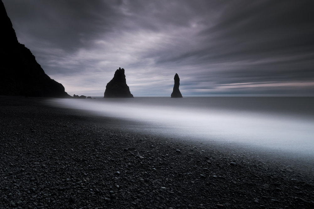 Reynisfjara The stunning rock stacks just near the town of Vik in southern Iceland seen from the black stone beach of Reynisfjara