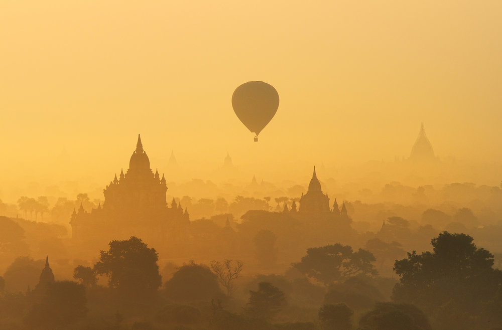 Bagan Sunrise   Bagan is certainly one of the highlights of any trip to Burma, nothing could have prepared me for the majesty of the place on my first misty morning there.   This has to be one of the most stunning places to see the sunrise on the planet.  A vast plain covered with temples, it's certainly one the most amazing mornings I've ever had photographing the dawn.  I shot for almost 3 hours at the top of a temple, from pre-dawn through the sunrise, and finally capturing warm light on the temples nearby.