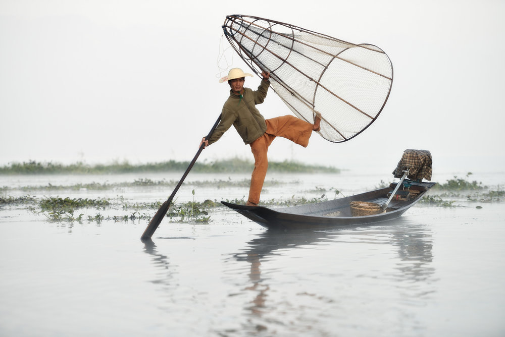 Inle Mist   A fisherman shows his incredible balance in the dawn mist on Lake Inle.