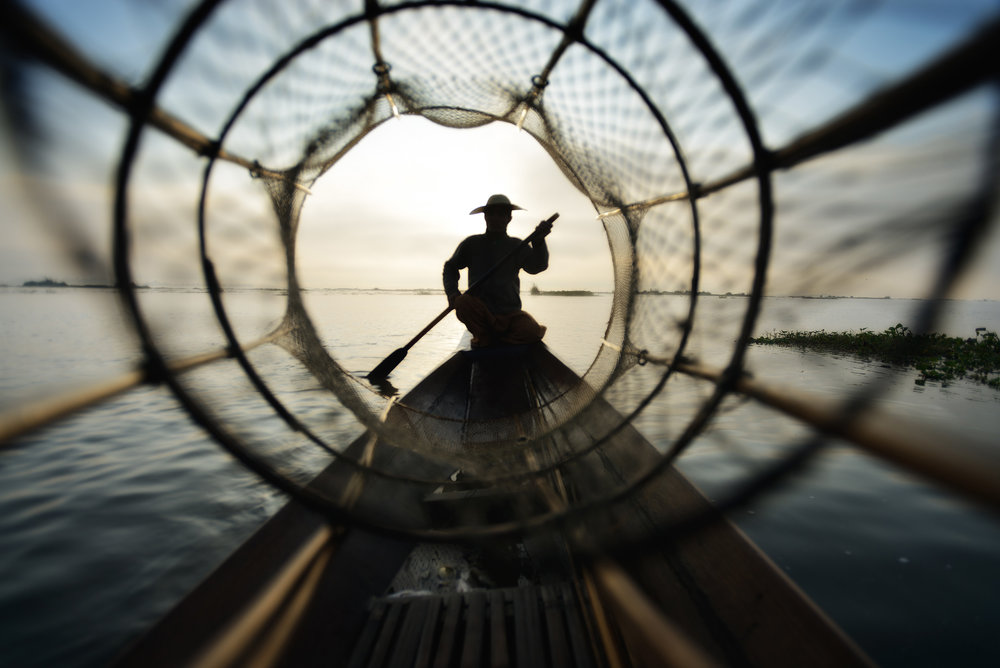 The Net   Looking through a fishermen's basket net on Lake Inle