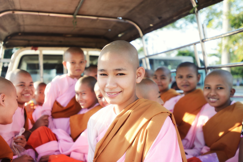 Yangon Nuns   We met this group of young Buddhist nuns just as they were about to leave a temple in the back of a small truck and were lucky that they were really happy to have their photograph taken. The fun in situations like this is seeing their smiles and laughter when you show people their photos on the back of the camera.