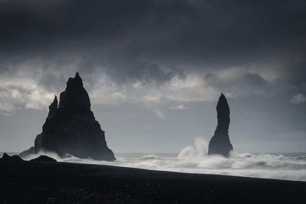 Waves batter the rock stacks at Reynisfjara beach