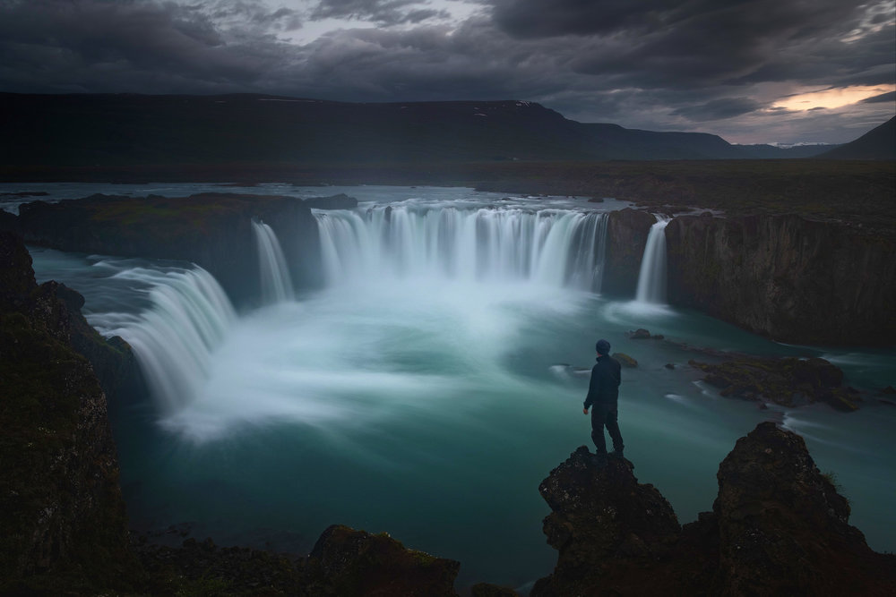 A self portrait above the falls of Godafoss around midnight