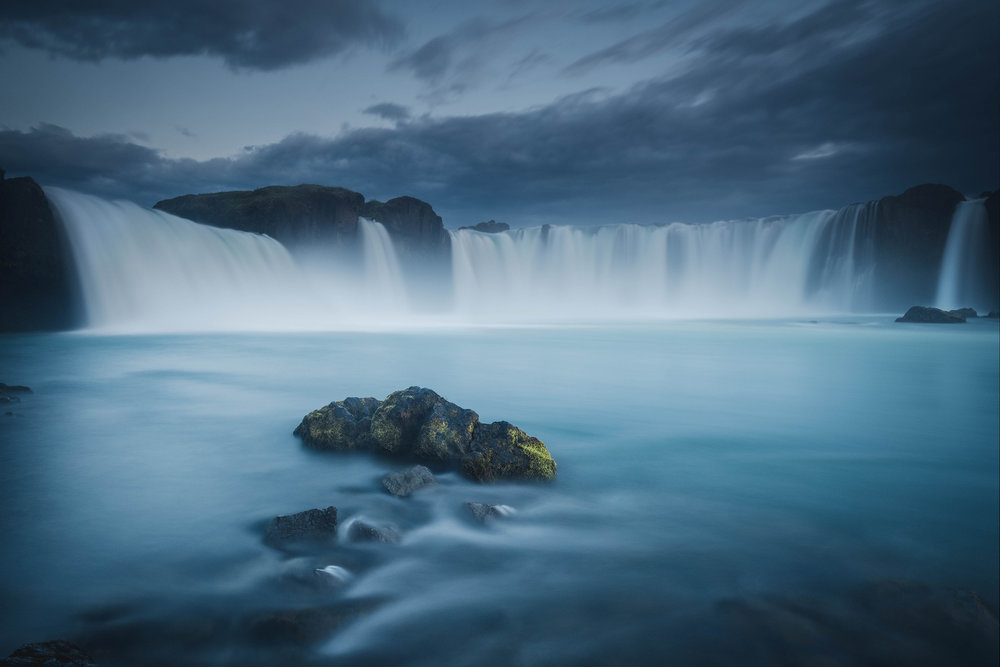 The blue hour at the base of the Godafoss waterfalls
