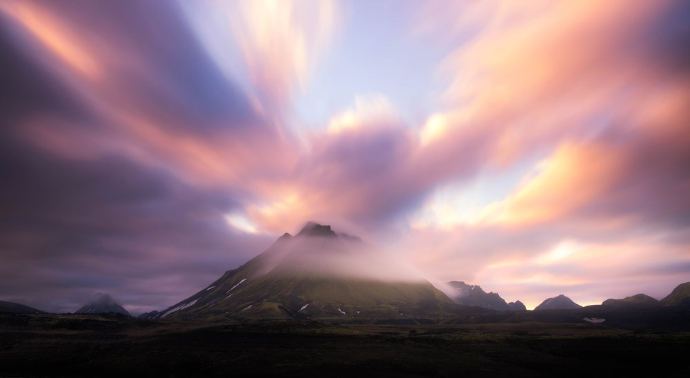A long exposure at sunrise as clouds flow around Hatfell