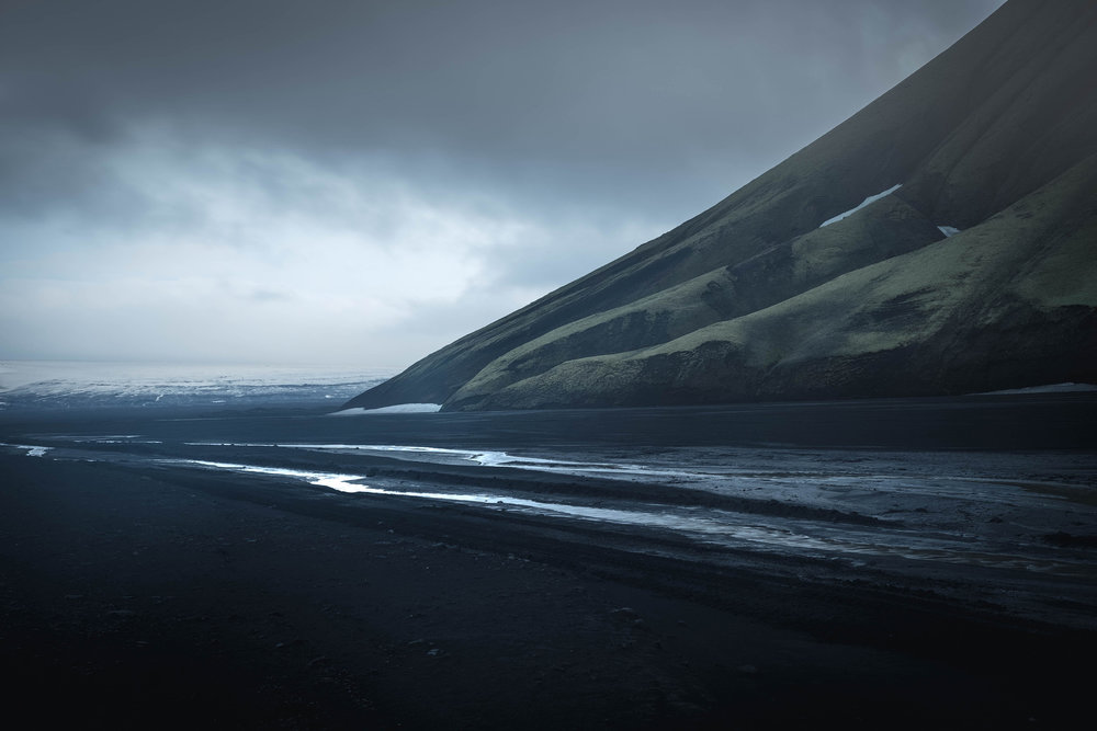 The foot of Maefell mountain on the Maefellsandur, the black sand desert at the foot of the Mýrdalsjökull glacier.