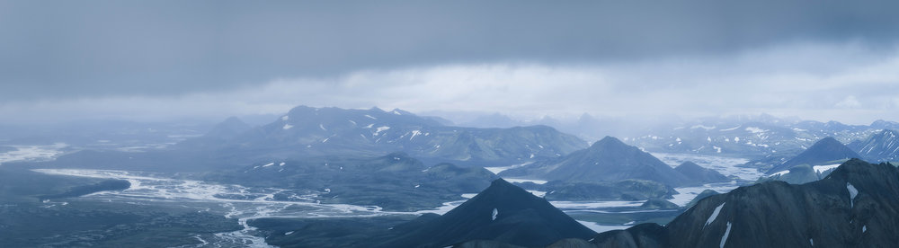 The distant lakes and rivers of the Highlands seen from the top of Blajnukur,