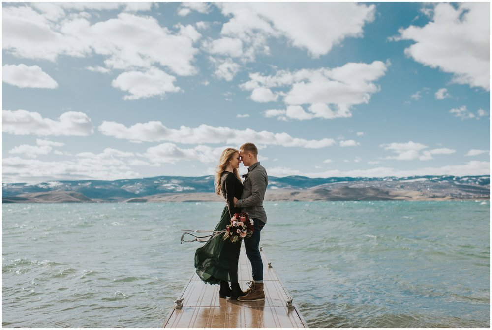 Couple hugging on a dock at the lake on their wedding day | Wedding Photographer Bear Lake Idaho www.riversandroadsphotography.com