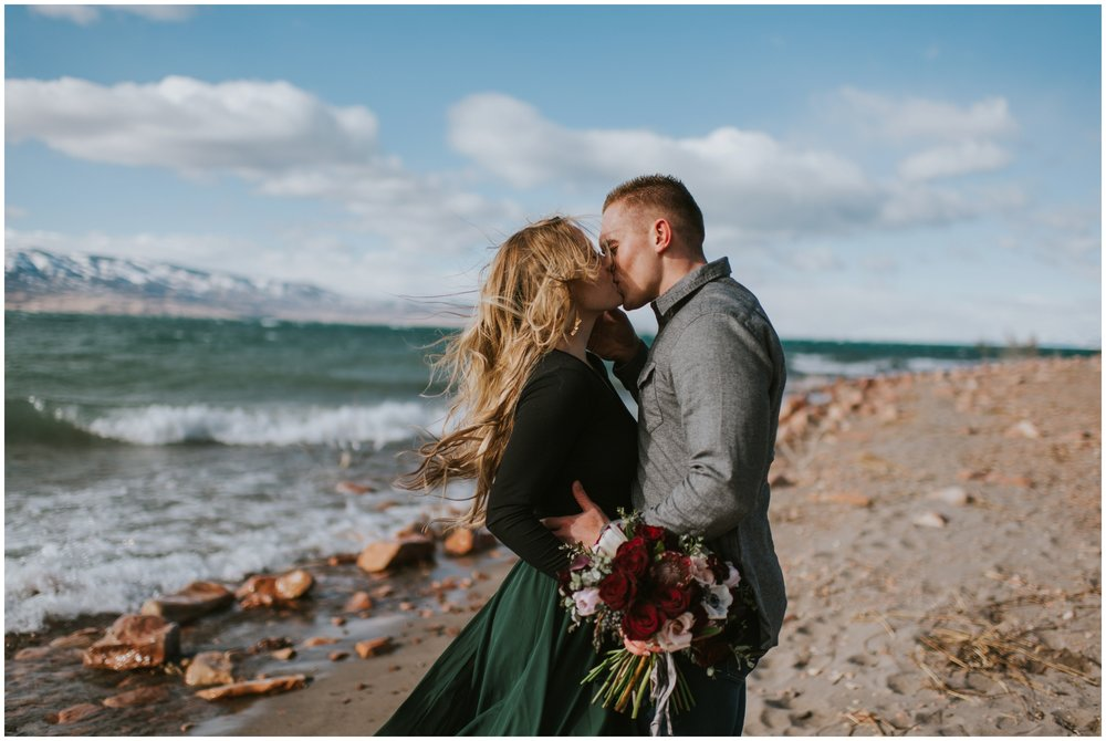 Couple kissing on the beach wind in her hair  | Wedding Photographer Bear Lake Utah www.riversandroadsphotography.com