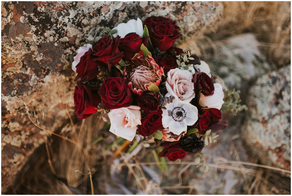 Brides bouquet with berries, red roses, blush roses and greenery  | Wedding Photographer Bear Lake Utah www.riversandroadsphotography.com