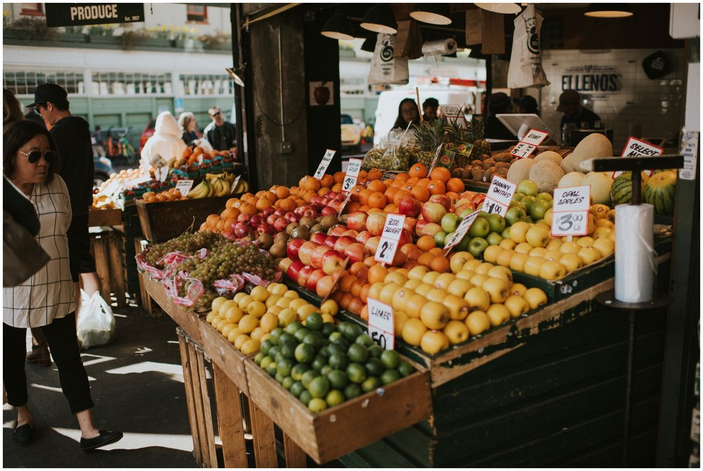 Fresh vegetable and fruit stand at pikes place market  | Seattle Engagement Photographer www.riversandroadsphotography.com