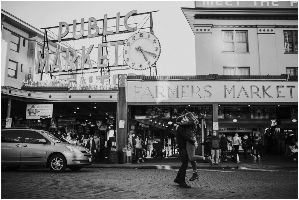 Guy picking girl up in the middle of the street  | Seattle Engagement Photographer www.riversandroadsphotography.com