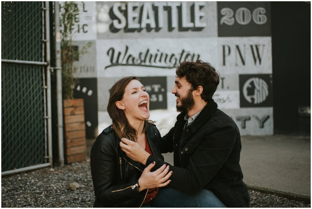 Couple session sitting and laughing  | Seattle Engagement Photographer www.riversandroadsphotography.com