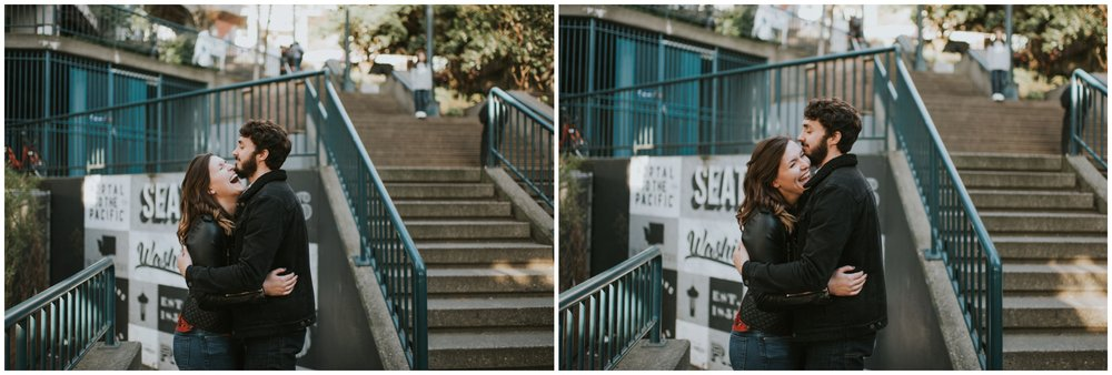 Engaged couple laughing on stairs downtown Seattle  | Seattle Engagement Photographer www.riversandroadsphotography.com