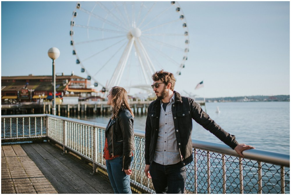 Candid couple posing at boardwalk  | Seattle Engagement Photographer www.riversandroadsphotography.com