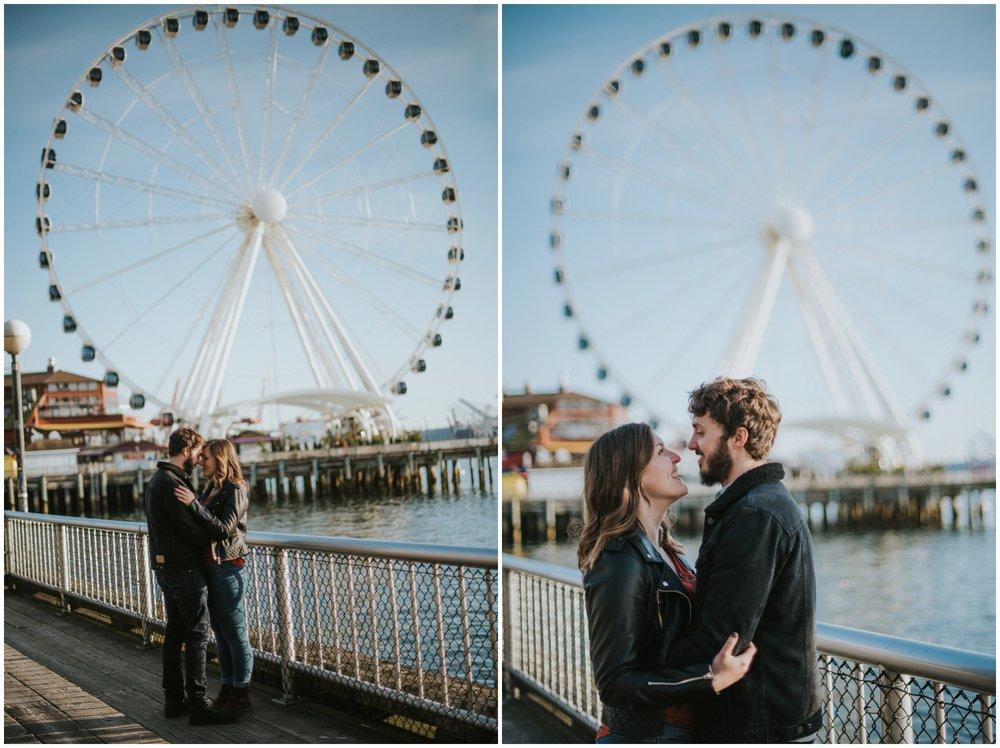 Couple posing on boardwalk with Ferris wheel | Seattle Engagement Photographer www.riversandroadsphotography.com