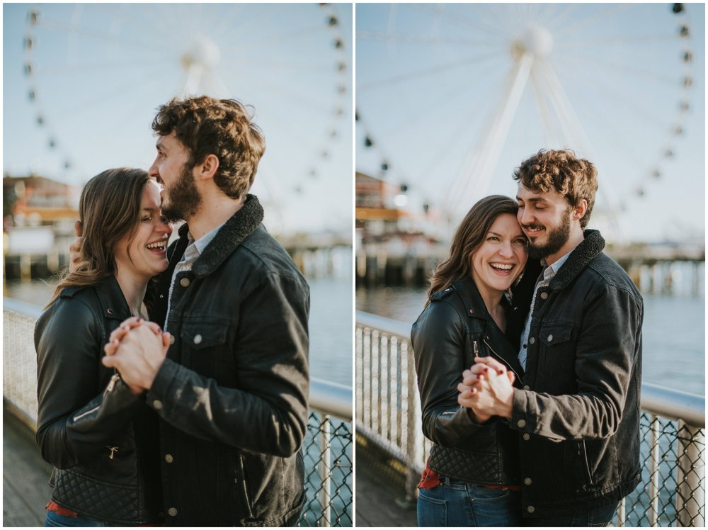 couple dancing on board walk with Ferris wheel  | Seattle Engagement Photographer www.riversandroadsphotography.com