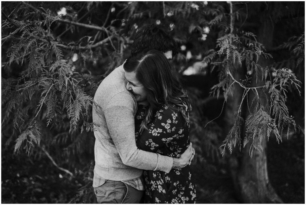 couple hugging in the forest | Seattle Engagement Photographer www.riversandroadsphotography.com