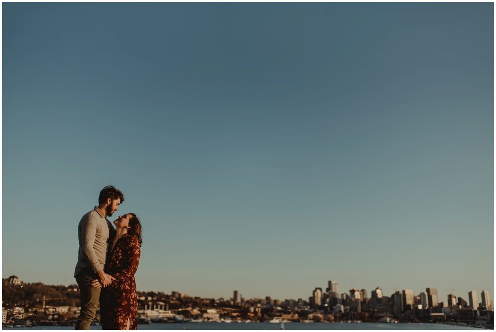 couple looking at each other at sunset | Seattle Engagement Photographer www.riversandroadsphotography.com