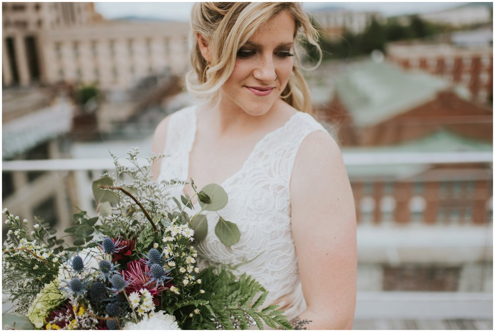 Bride bouquet, rooftop wedding, center in the square roanoke Virginia  | www.riversandroadsphotography.com
