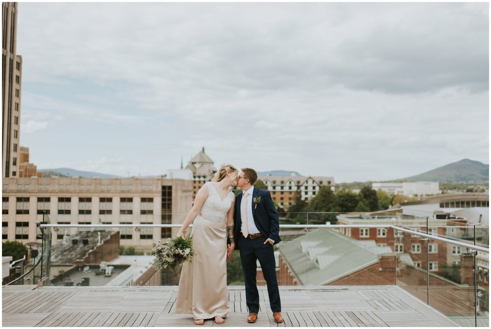 Brides kissing on rooftop, center in the square, downtown roanoke wedding  | www.riversandroadsphotography.com