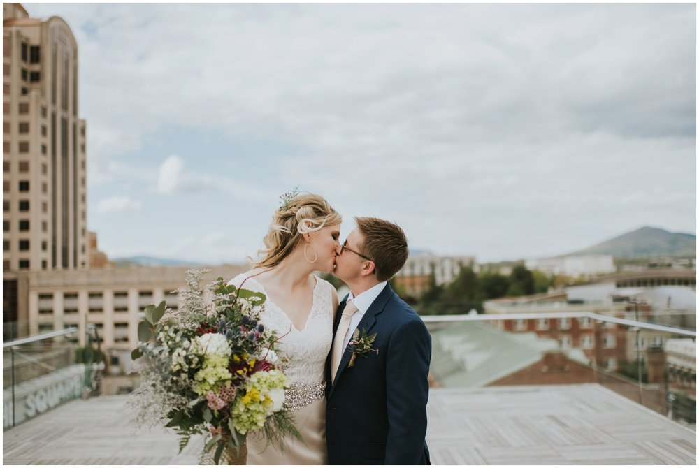 Couple kissing on wedding day. Downtown Roanoke  | www.riversandroadsphotography.com