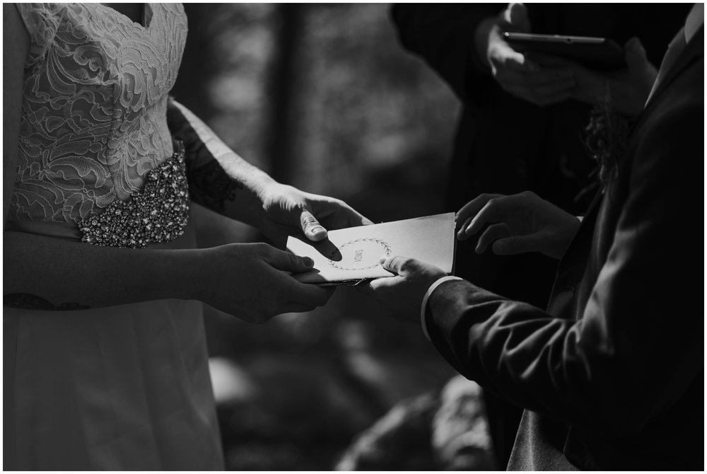 Couple sharing vow book during ceremony | www.riversandroadsphotography.com