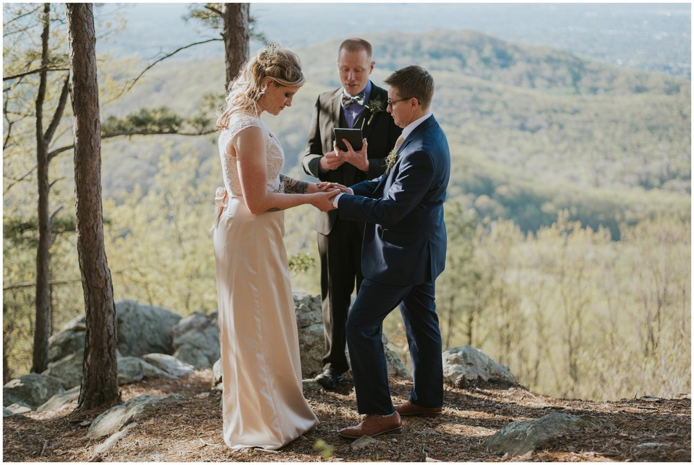 couple getting married ontop of roanoke mountain overlook | www.riversandroadsphotography.com