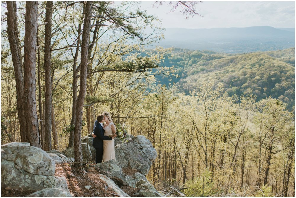 couple kissing ontop of a mountain | www.riversandroadsphotography.com