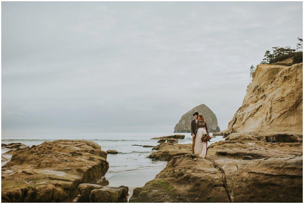 Elopement at Cape Kiwanda, Couple posing on rocks | Oregon Wedding Photographer www.riversandroadsphotography.com