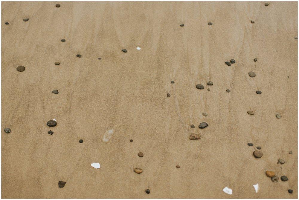 Rocks in the sand at Cape Kiwanda, Pacific City Oregon | www.riversandroadsphotography.com