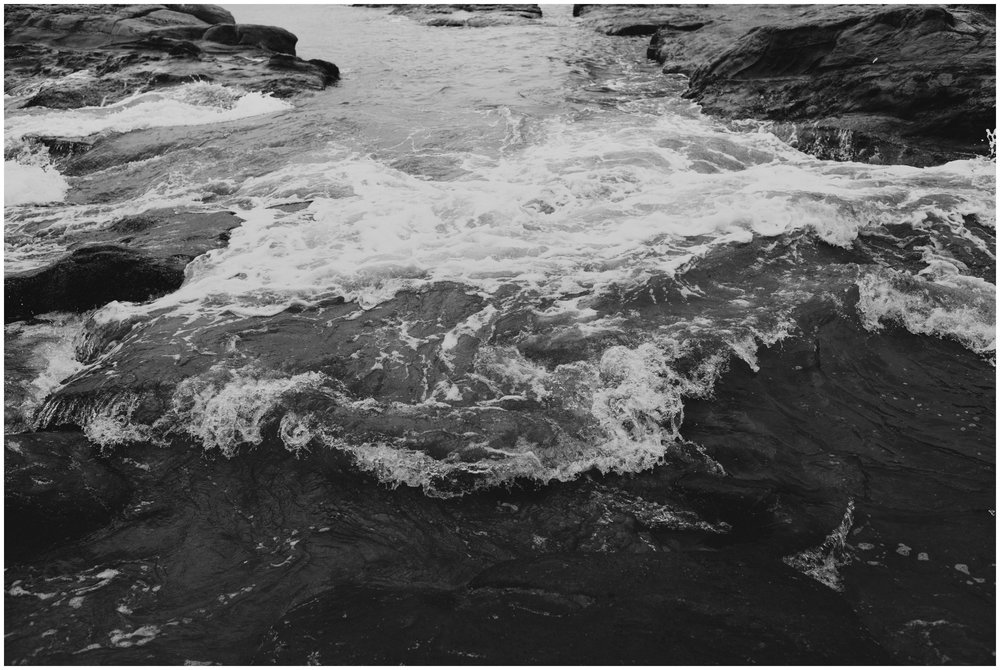 Black and White Photo of the water rushing at Cape Kiwanda Pacific City Oregon | www.riversandroadsphotography.com