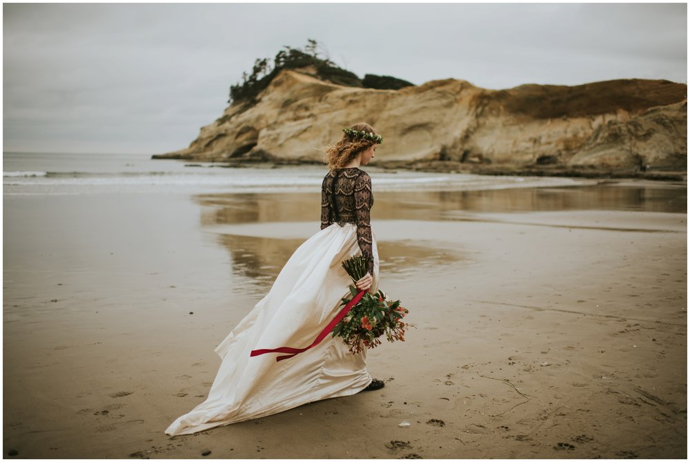 bride walking on the beach in pacific city | Oregon Wedding Photographer www.riversandroadsphotography.com