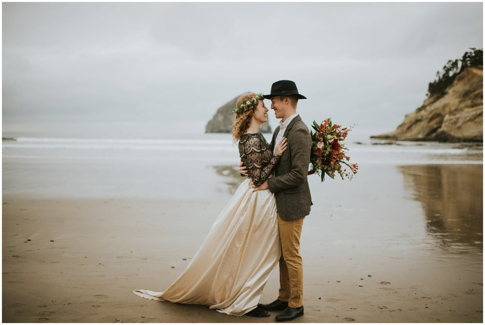 Couple holding each other and laughing on the coast | Oregon Wedding Photographer www.riversandroadsphotography.com