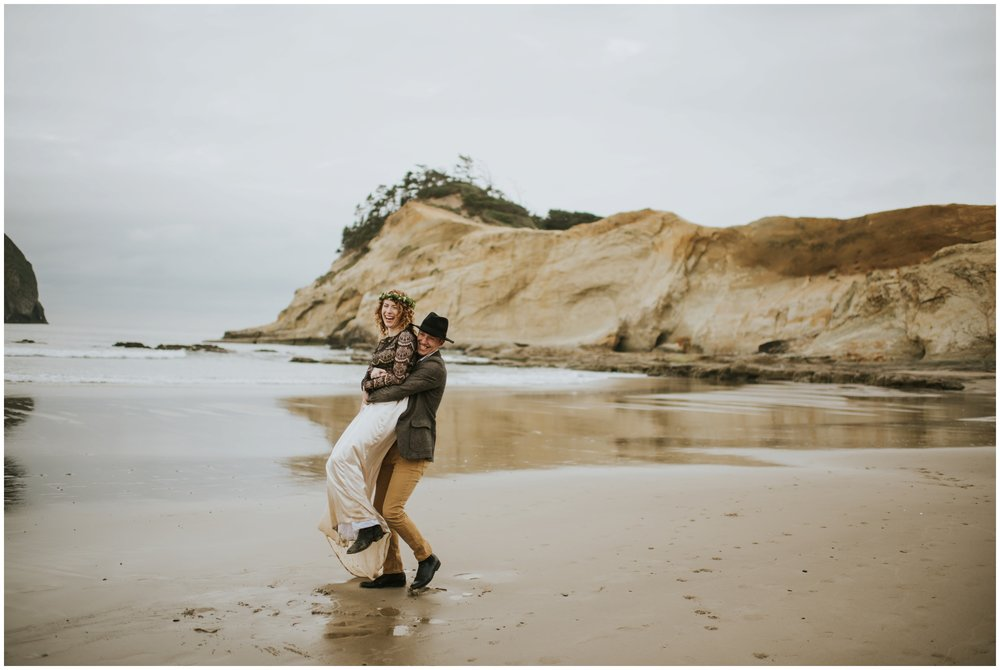 guy spinning girl on the beach  | Pacific City Wedding Photographer www.riversandroadsphotography.com