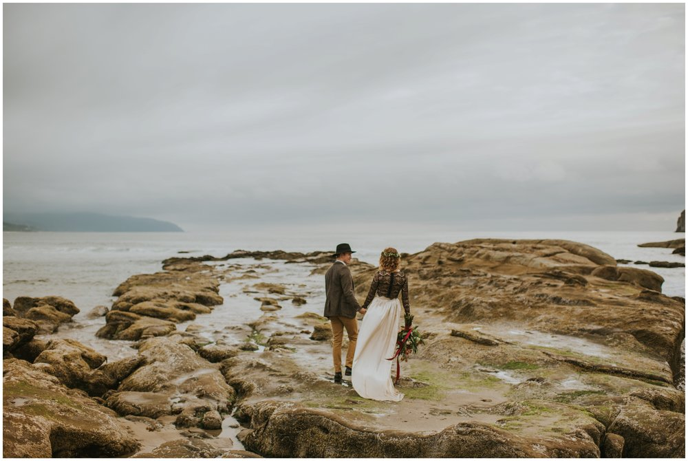 walking together elopement at cape kiwanda  | Pacific City Wedding Photographer www.riversandroadsphotography.com
