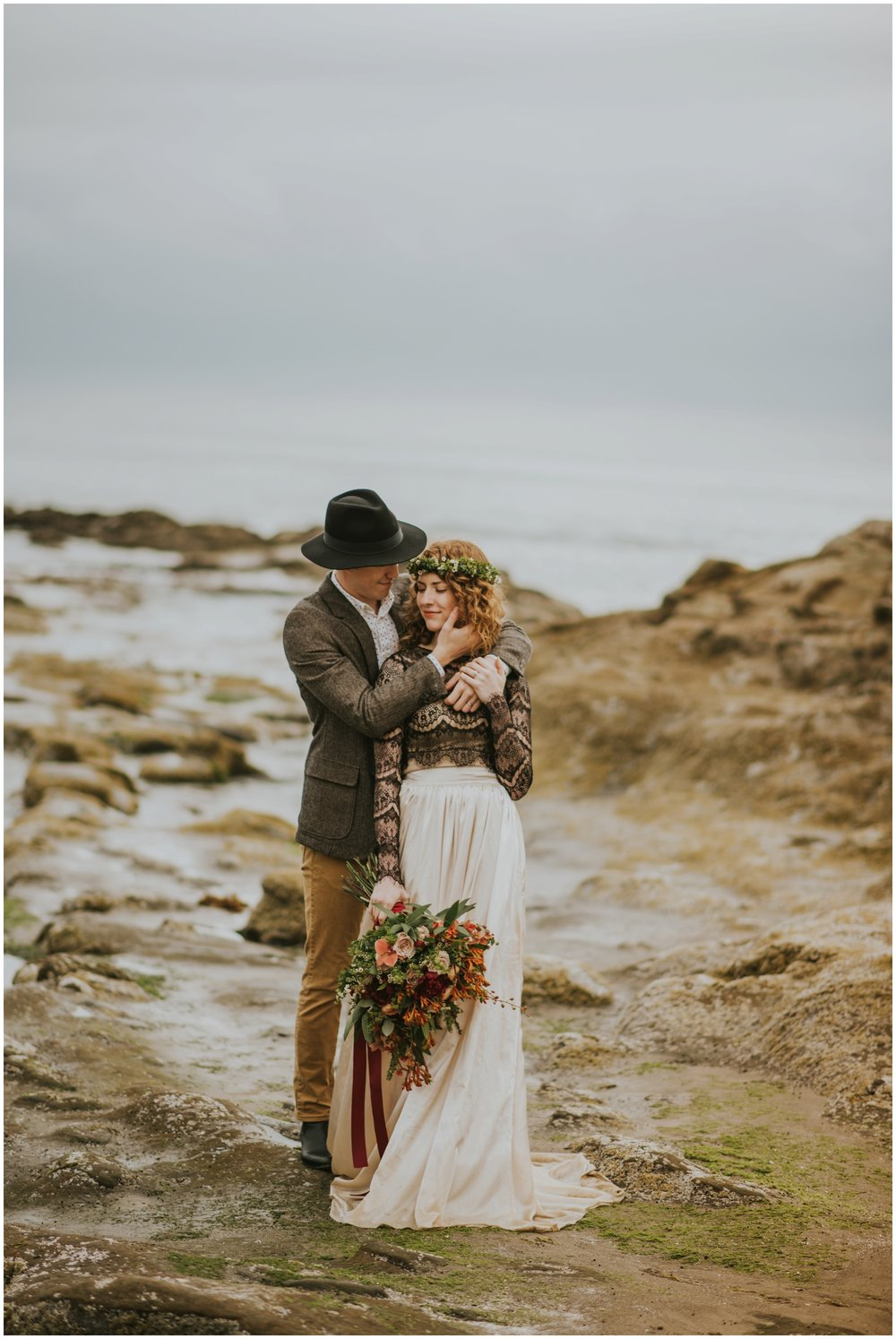 couple holding each other close on the rocks at cape kiwanda  | Pacific City Wedding Photographer www.riversandroadsphotography.com