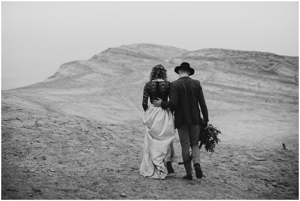 couple walking away at cape kiwanda  | Pacific City Wedding Photographer www.riversandroadsphotography.com