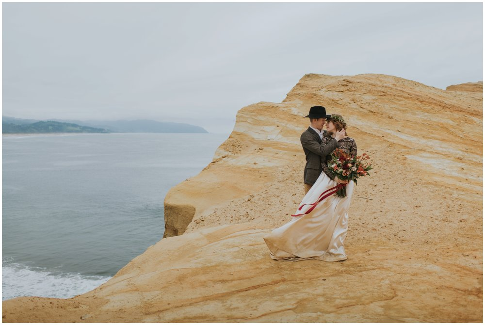 standing on the edge of cape kiwanda  | Pacific City Wedding Photographer www.riversandroadsphotography.com