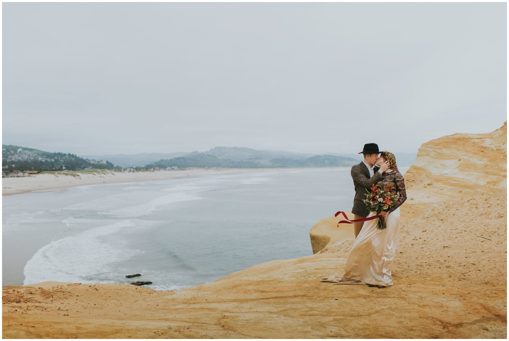 couple kissing on the edge of cape kiwanda  | Pacific City Wedding Photographer www.riversandroadsphotography.com