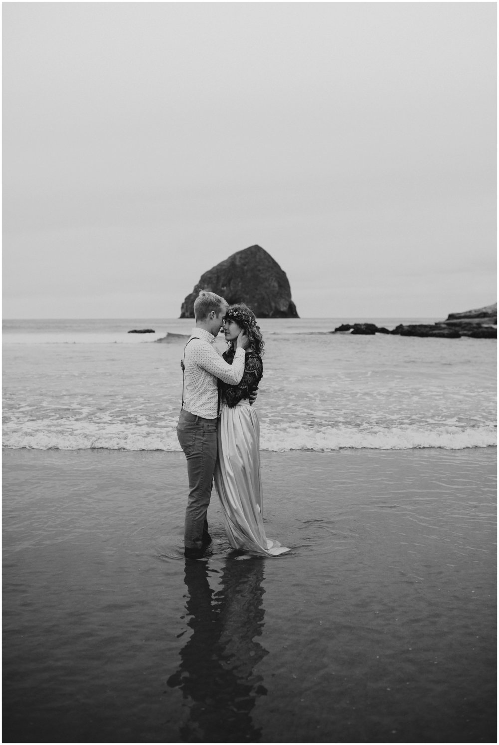 black and white portrait of bride and groom in the water  | Pacific City Wedding Photographer www.riversandroadsphotography.com