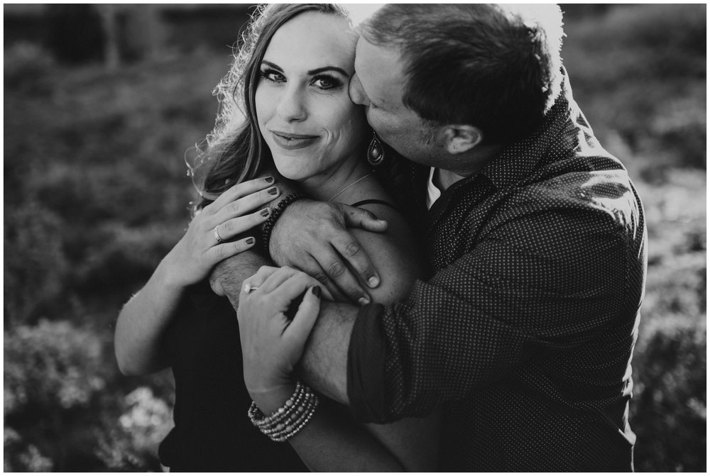 black and white photo couple cuddling in the outdoors. Tony Grove Campground Logan Utah Engagement Photos. www.riversandroadsphotography.com