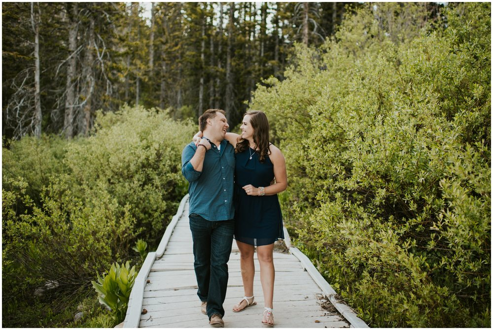 Couple walking on bridge. Engagement Photography. Tony Grove Campground engagement.