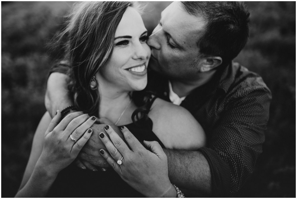 cheek kisses. black and white photography. engagement photographer Logan utah. www.riversandroadsphotography.com