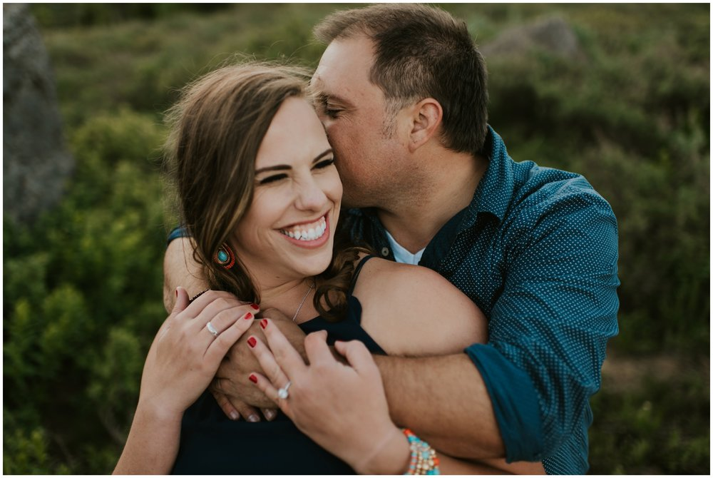 couple laughing during engagement session at Tony grove campground in Logan, Utah. Engagement Photographer.