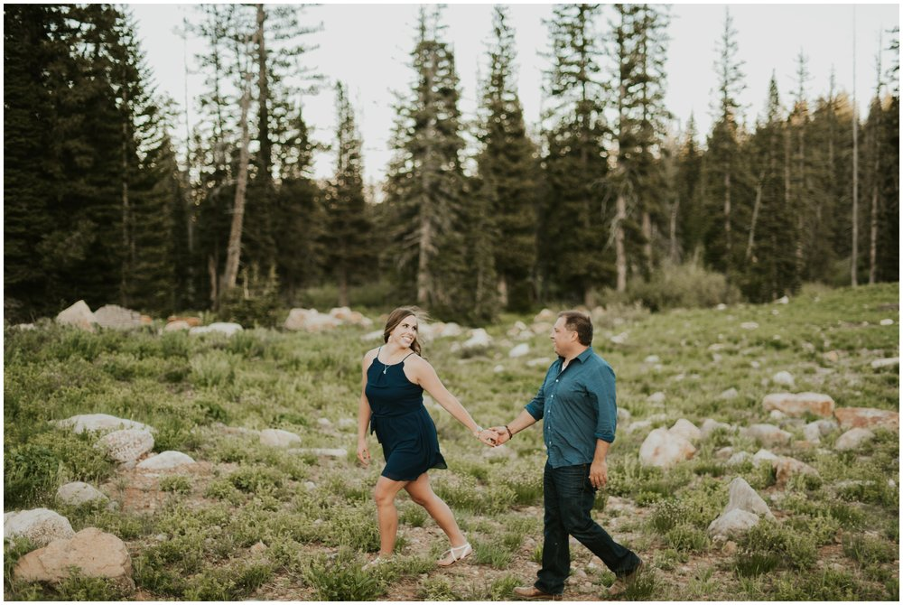 couple holding hands and walking at Tony grove campground in Logan Utah. Engagement photography.
