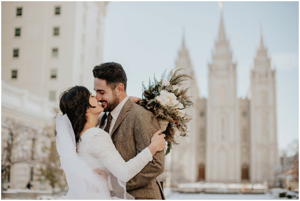 intimate wedding photography, couple kissing at the salt lake city temple www.riversandroadsphotography.com