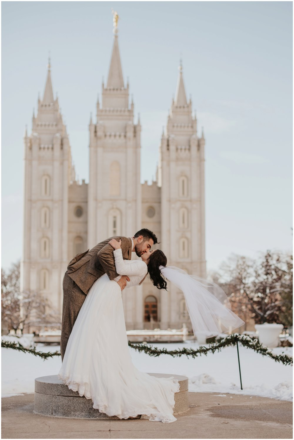 Bride and Groom Dipping Portrait at Salt Lake City Utah Temple www.riversandroadsphotography.com