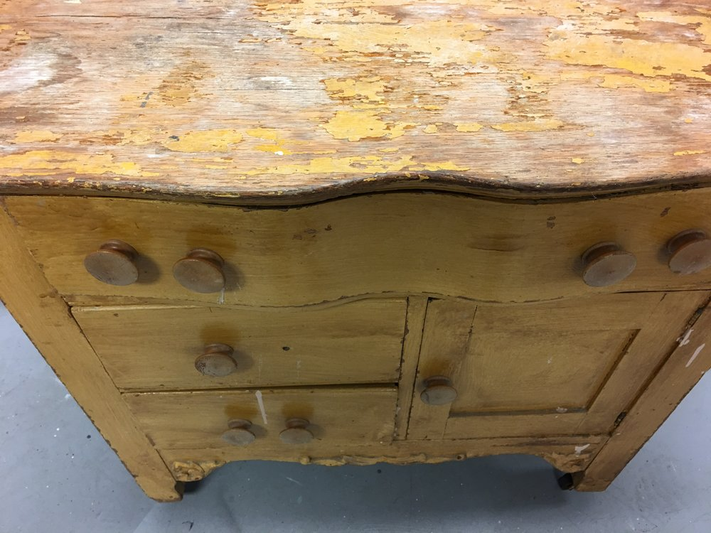 Decades of neglect made this dainty dresser an eye sore.