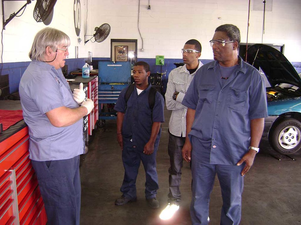 Disabled students receive instruction in garage
